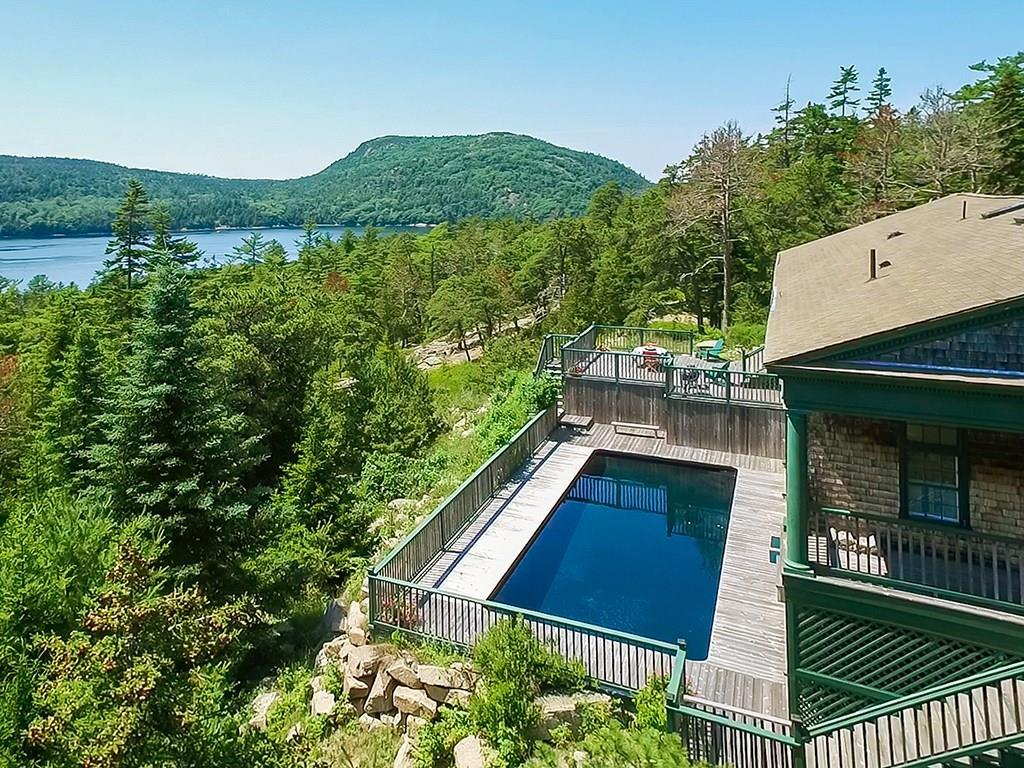 View to NW with deck and heated pool...