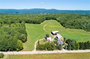 Private antique cape farmhouse with 2 large barns and 140 acres