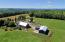 Property consists of home with large antique barn, second barn with new solar array, chicken coop and garage/barn, organic gardens, perennials, and fruit trees