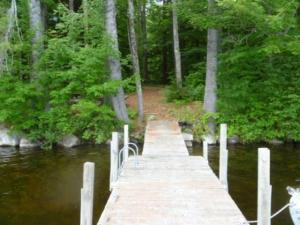 1.37 wooded lot with shared water access.