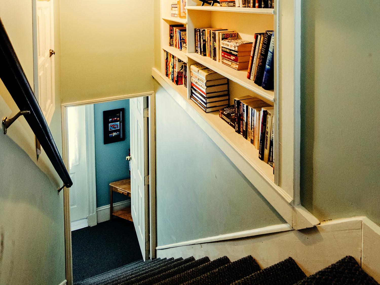 3rd floor stairs and bookshelves-MLS