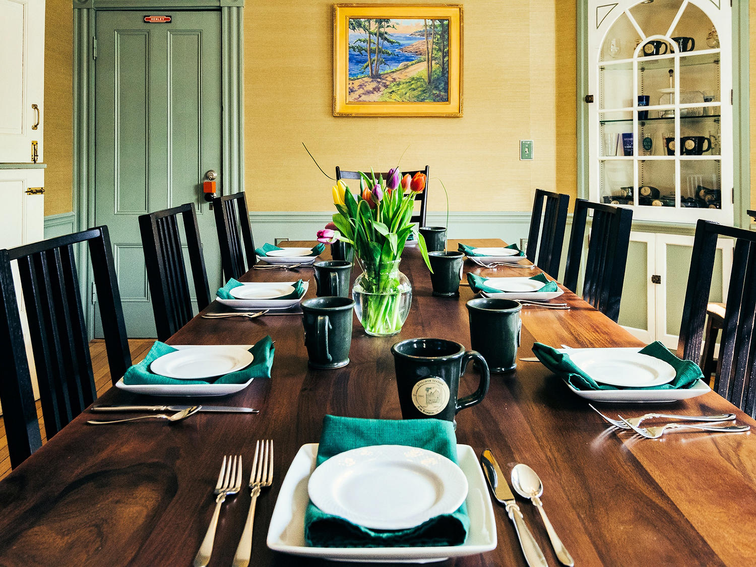 Dining room with table set for breakfast