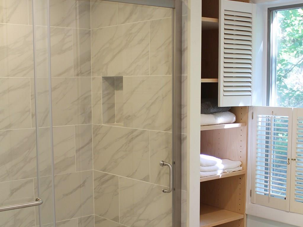 New shower with tiles and storage...