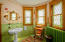 Maria Suite bath with stained glass windows