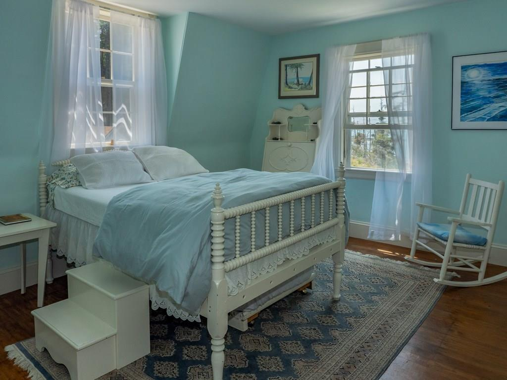 Light-filled guest room with...