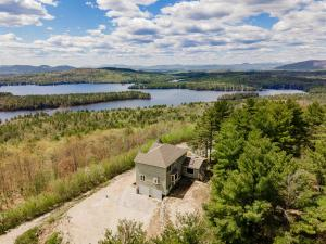 Hilltop privacy, views and acreage await you.
