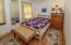 1st floor bedroom with charming wood bedframe