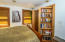 Studio: Photo is showing the murphy closet open (both sides of the bookshelves open).