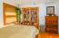Studio: Bedroom in studio area off diningroom (murphy closet is a cool secret closet hidden behind the bookshelves).