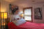 Studio: just a few steps up to your own private space in the studio area that currently has 3 rooms (1 Bedroom, 1 open area that could be a bathroom, another area used as a den could be a kitchen & livingroom for an apartment).