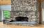 Stone floor to ceiling fireplace