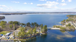 Welcome to Sebago Lake Lodge! Unit #3 Room 6 is now for sale in main building with boat slip 34!