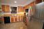 Kitchen with plenty of natural lighting throughout
