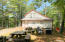 211 Caldwell Ln. Picnic area and exterior of camp.