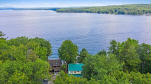 Welcome to 79 Whites Point Road, Standish in the coveted Whites Point Community with water frontage on Jordan Bay, Sebago Lake Maine!