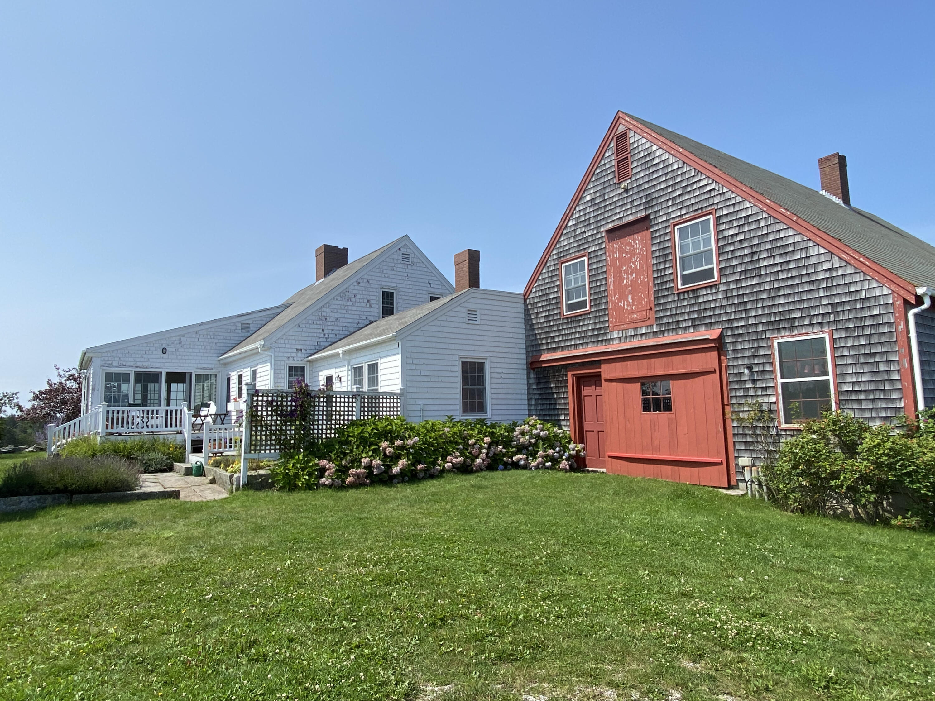 A rare and special opportunity to own a beautifully maintained farmhouse with breathtaking elevated ocean views and shared dock rights on Vinalhaven's east side.   The classic residence is sited at the top of Poole's Hill and has been expanded and renovated overtime. The farmhouse has central heat and  includes a large eat-in kitchen, dining room, living room with fireplace, sunroom, guest bedroom and full bath on the first floor, with an ensuite master, guest bedroom, and full bath upstairs. The attached barn includes a lovely library/den and study on the first floor with 2 bedrooms and a bath up. Above the barn/garage is an unfinished room that, with dormers, could be transformed into another room with elevated ocean views. Connecting the two living areas is a generously-sized pantry and laundry area with  painted floors, built in cabinetry and slate sink. Existing easements shared with neighboring properties protect the natural beauty, habitat, and classic qualities of this very special area. This is the only available property with 14 acres of open meadow, a shared deepwater dock, and an iconic Maine home oozing of charm inside and out!