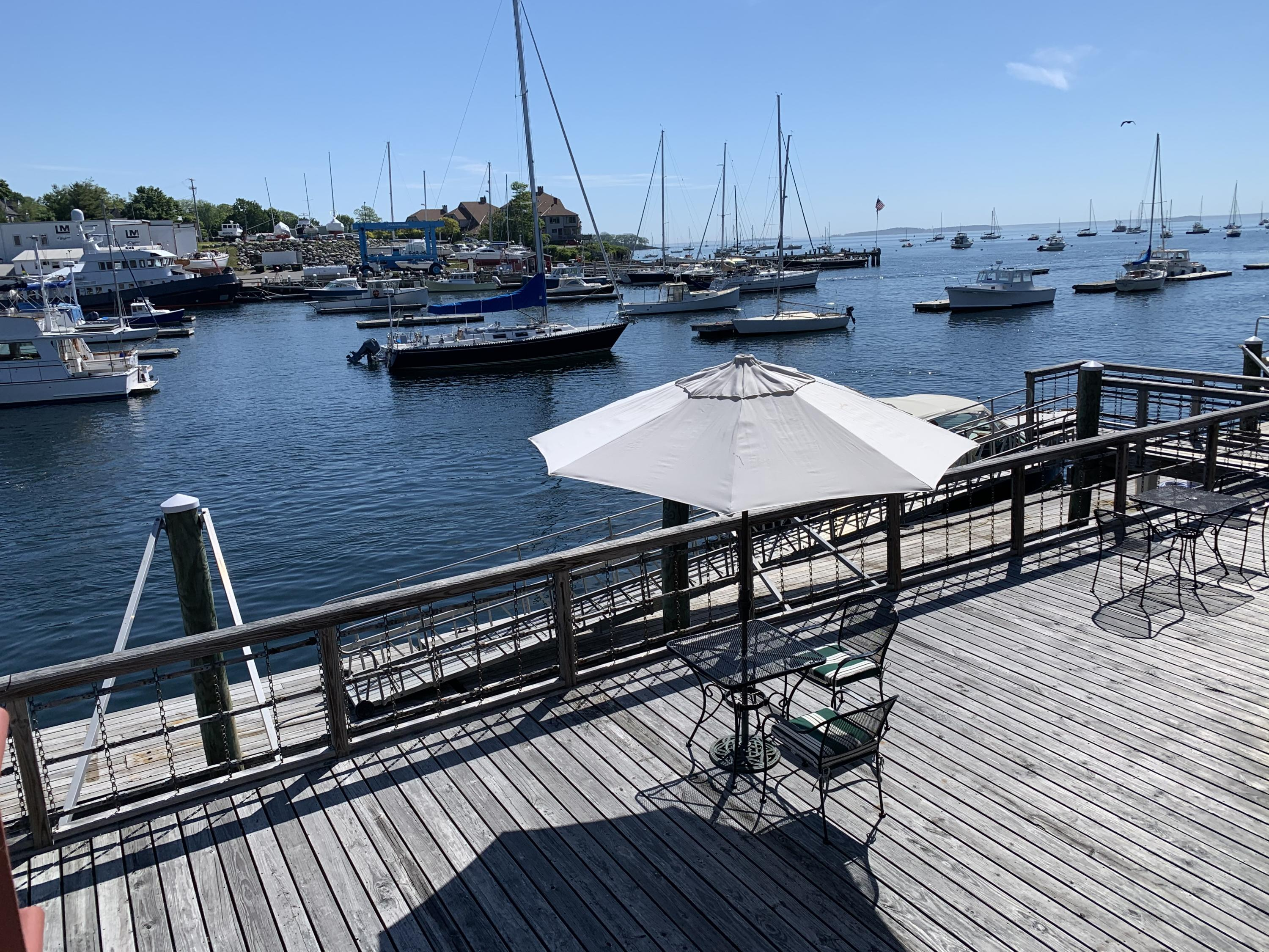 On the water in the heart of Camden, this waterfront townhouse condo has 180' views from the Camden Hills to the harbor islands and beyond. Enjoy watching the boating activity in the harbor from your private deck, or tying up your boat on your share (23' +/-) of the seasonal waterfront dock. Carefully maintained, this property is ready to move in and enjoy. Three levels of bright and airy space with two private decks accessing the spectacular views and salt air. Third floor is accessed by a spiral staircase to the open loft-like space, perfect for an office or bonus room. Harbor Square is nestled among the shops and restaurants of Camden, and a stone's throw to the Camden Yacht Club. Parking garage underneath with two deeded spaces.