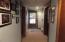 Downstairs hallway showing door to deck overlooking the lake