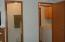ensuite bath and washer/dryer in hallway
