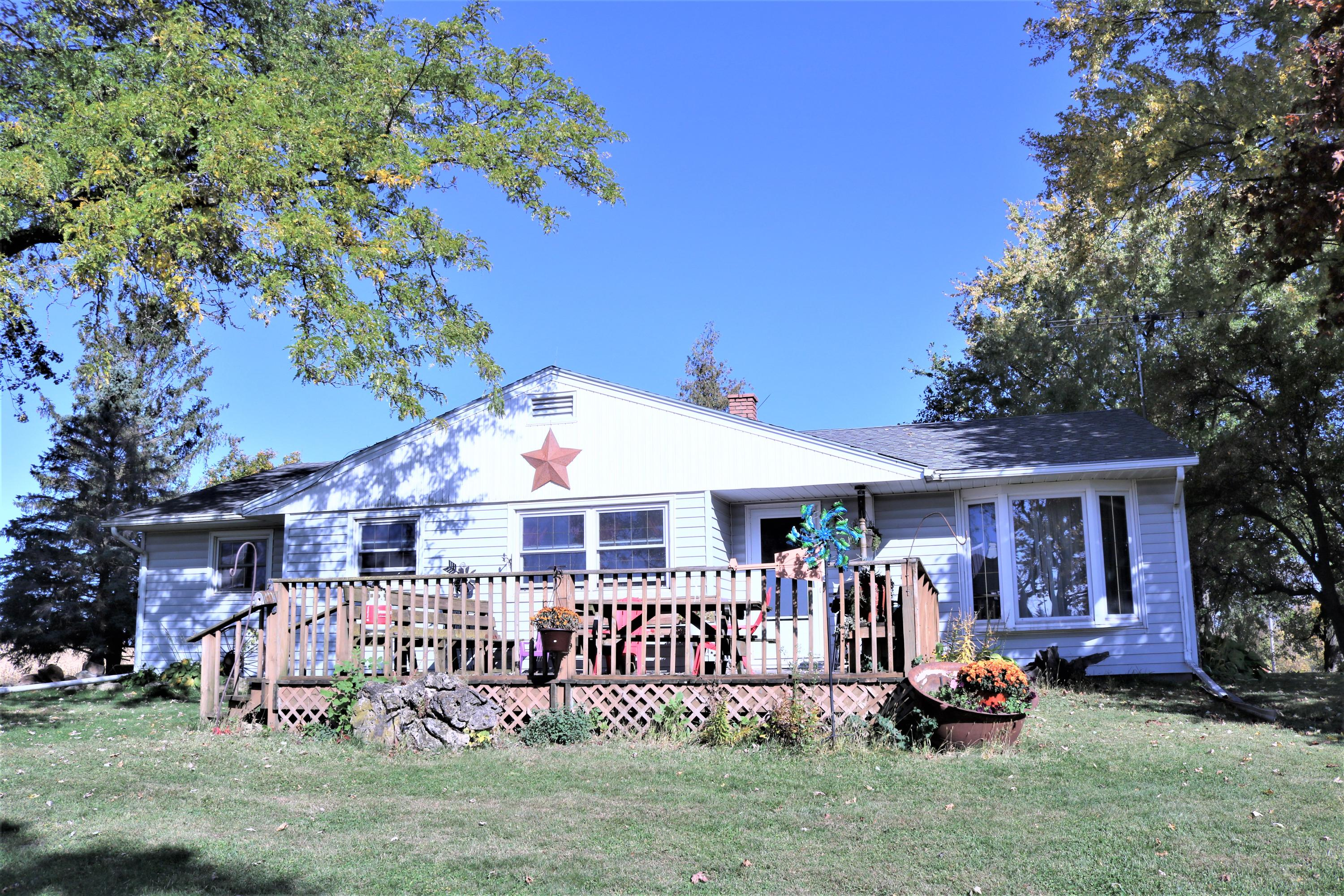 Rural, ridge-top farmette! Home is a 2-3 bdrm, 1.5 bath stick-built ranch with full basement. Large office could be used as a bedroom or home-based business. Many outbuildings including a 2-car detached garage, L-shape barn 80' X 16' with a 56' X 35' wing, 2 28' X 80' sheds one metal and one wooden. 1 28' X56' shed. Currently used as a calf raising facility. The 10+/- acres consists of approximately 5 tillable (corn this year) and 2 fenced pasture. Bring your ideas and animals!