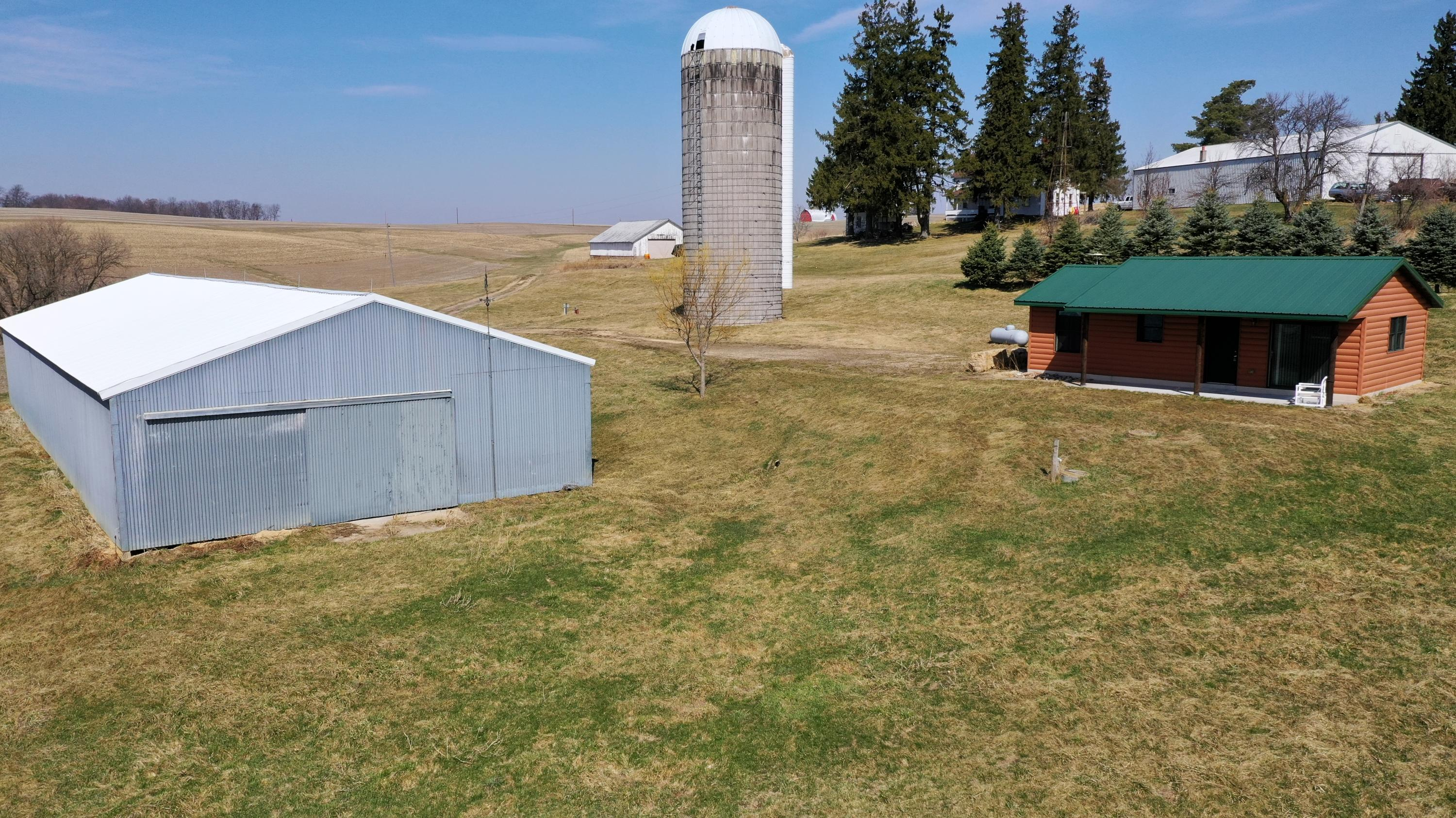 126.84 surveyed acres with well built and maintained 1 bedroom/1 bath get away cabin. New drilled well, holding tank septic system (could be converted to drain field) and 40X100 machine shed. Man made pond with earthen dam holds water year round and hasn't algaed over! Land consist of 66+/- tillable, 29 wooded(MFL), remainder pasture/building site. Great location within 30 minutes of La Crosse. A short distance from Class A trout streams! 3 hunting stands, ATV trails, plenty of room for horses, livestock, row crops, gardening and enjoying rural life! Smaller parcels available! MLS#1733484(10+/-acres with cabin and pole shed) MLS#1733486(66+/- acres of vacant land)