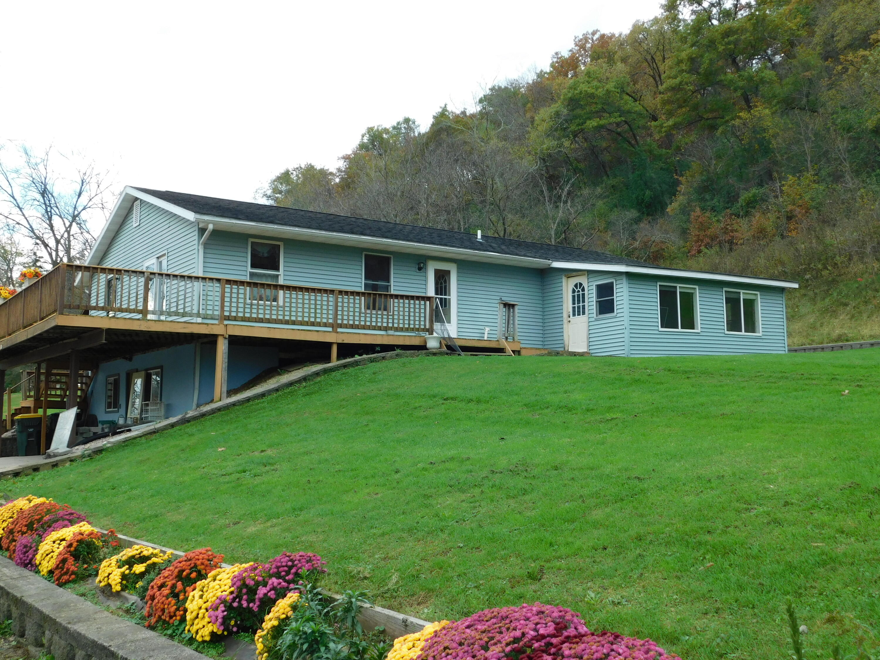 A little bit of county in the Village of Readstown. 3 bedroom 2 bath home nestled on 2.90 acres with a view of the creek. Beautiful outside area with retaining wall for outside entertaining. A 26 X 20 Cement floor shed is included!