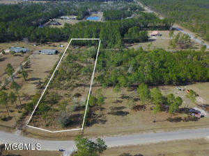 Great piece of property to build on or place mobile home.  Power, well, and septic are already on the land.  Partially fenced and wooded in the back for privacy.