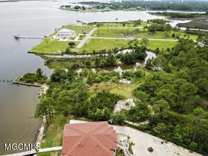 Prime waterfront property totaling 6.9 acres. Panoramic- Stunning views of Back Bay! 800 linear feet of bulkhead ('as-is' conditionBoat launch (as-is), 5 deep water boat slips - 3 outside, 1 large & 2 small keyhole slips can be cleaned out and used for outboard and outdrive vessels. Must see to appreciate!