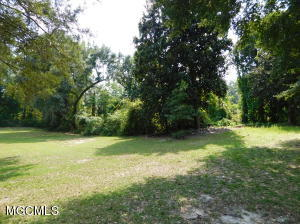 Beautiful and private homesite. One of a kind 1 acre on a dead end street, prime location on the OS bike path.