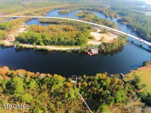 Beautiful home site on the Biloxi River. Over 2 acres with gorgeous trees! This well established subdivision is convenient to I-10.