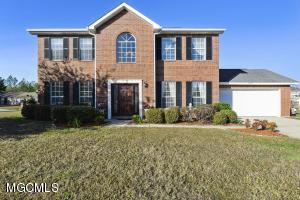 Beautiful spacious, well maintained home on a corner lot in Ocean Springs School District. This home is turn key ready with gorgeous granite countertops in both the kitchen and bathrooms. This home offers both formal and informal dining, large bedrooms, crown molding, fireplace and a patio. Come make this home your own before it's gone! Minutes from OS Highschool!