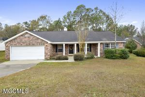 Cute Cute Cute!!!!  Home has three bedrooms and  2 baths, is a split floor plan, has a vaulted ceiling in the living room with a fireplace,  an open kitchen and inside utility room.  Conveniently located easy access to Hwy 90 and/or I-10.  Buyer to verify sq ft