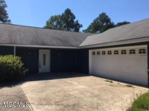 Great 3/2 bedroom, 2 bath starter home!  Freshly painted inside and out and new flooring throughout.  Third room could be bedroom and/or office.  Close to Ocean Springs High School.  Buyer to verify sq ft