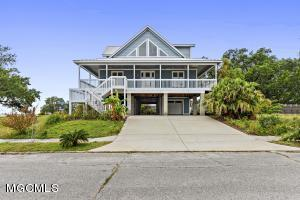 This Biloxi gem is only 2 lots away from Miramar Park and walking distance to the beach. Enjoy fantastic water views from the huge windows and wrap around porch. If location isn't enough then this custom 3 bed, 2 full and 2 half bath house is packed with custom details. This Chef's kitchen has high end stainless Thermador appliances complete with an infrared shelf to keep food warm.  If open kitchens don't impress you then take a look at the custom shower with loads of jets to soothe your aching muscles. This home has the much-coveted metal roof, fireplace, and plenty of entertaining space inside and out. Revel in a full day at the beach and then walk home to your very own private tiki Bar. This home is a must see with photography opportunities off your porch. Casino life only minutes away