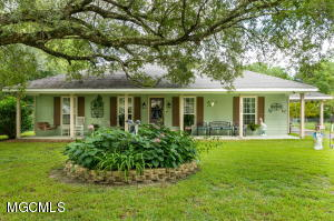 Custom Home Nestled under beautiful oaks.