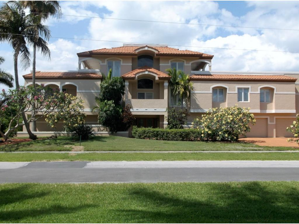 Owner/Agent. Huge custom home on one of the most exclusive blocks on Marco Island in area of new homes. Live on deep canal only moments from Caxambas Pass. Inviting entry foyer leads to living space above the flood plain rated AE. Large kitchen has 2 stainless steel quiet Bosch dishwashers and has double gas ovens. The home has two separate family rooms, a spacious dininng room and formal living room. Recessed lighting is throughout home,, 3 central a/c units keep temperatures perfect. Extensive security system. Unique bathrooms. Oversize pool 40' x 25' on second level in expansive walled concrete deck make this house very enjoyable and private. Arches on deck provide shade. Master bedroom suite has access to pool. Home is on sewer. Buyer assumes remaining assessment at closing, currently $1,6356 Guest Suite on Level 3 has its own sitting area,bar . Immense first floor used for storage or could make a great family room. Garage can hold 5 or more vehicles. Car enthusiasts will love this first floor space. View Dolphins, Rays and Manatees as they swim by and Egrets, Pelicans and sea birds flying overhead from your pool deck. This is a nature lovers paradise! Offered Unfurnished.
