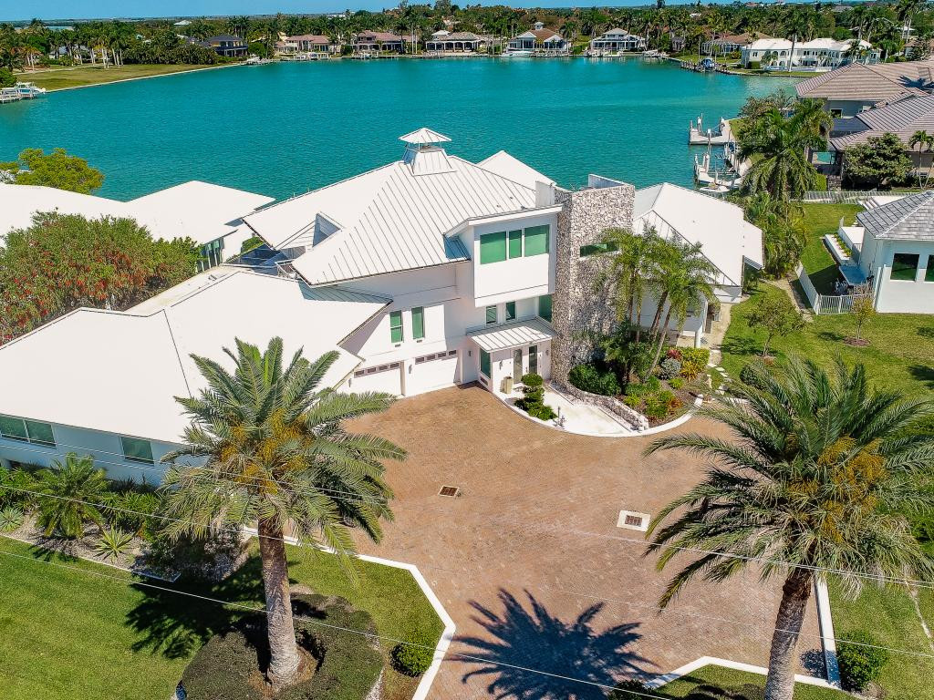 This contemporary estate is located on quiet Fredrick's Bay with a unobstructed bay view. The Miami Vice style property was designed to capture the ultimate bay views where you can enjoy seeing the dolphins and manatees throughout the day. The house has been updated and remodeled in the last 5 years. It features a new roof, new kitchen, new bathrooms, new a/c systems and all impact windows and doors. It has an upper level sanctuary for guests with the most stunning views. The property also features a custom built fireplace, air conditioned boat storage, two boat lifts and a large patio terraces for outdoor entertainment. This is a one of a kind, unique and inspiring masterpiece of construction.