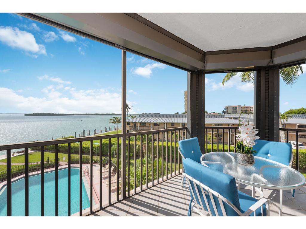 Take in amazing wide water views of Caxambas Pass from this Turnkey-Furnished, 3BR condo at Camelot on Marco Island! Just seconds out to the Gulf of Mexico. The interior is light and bright thanks to SE exposure and ample windows, plus 2 spacious, tiled lanais, accessed via glass sliders. The eat-in kitchen has granite countertops, tile backsplash, and plenty of cabinet space, Whirlpool and LG appliances, plus a pass-through window to the formal dining area, for ease of entertaining. Inviting Master Suite with large closets and en-suite with dual sinks and tile shower. 2 additional bedrooms on the split plan, 1 with lanai access, plus full bath for guests' privacy. Float the day away in the sparkling community pool overlooking the Pass. 1 parking space under the building. Assigned storage unit on ground floor. Just minutes to Marco Island's gorgeous beaches and world-class shopping and dining. Great monthly rental potential as well!