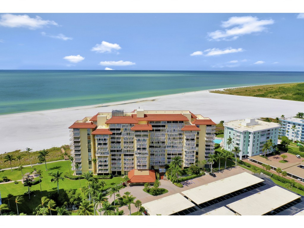 This 2 bedroom and 2 bathroom beachfront condominium is not only located on the beach, it is also within walking distance to some of Marco Islands finest dining! Featuring a split-bedroom floorplan, highlights include walk-in closets and outdoor access for both bedrooms, a spacious lanai for eating and relaxing, new impact-resistant sliding glass doors, and beautiful views of the city. The Tradewinds building offers access to a large heated pool, a boardwalk to the beach, an outdoor seating area with grills, a community room, a library, extra storage, common laundry rooms on each floor, and an assigned covered parking space. Whats more, this unit boasts a strong rental history, and the common areas will soon be beautifully renovated with no additional expense to the owners. Heres your opportunity to claim a piece of beachfront living for a very reasonable price!