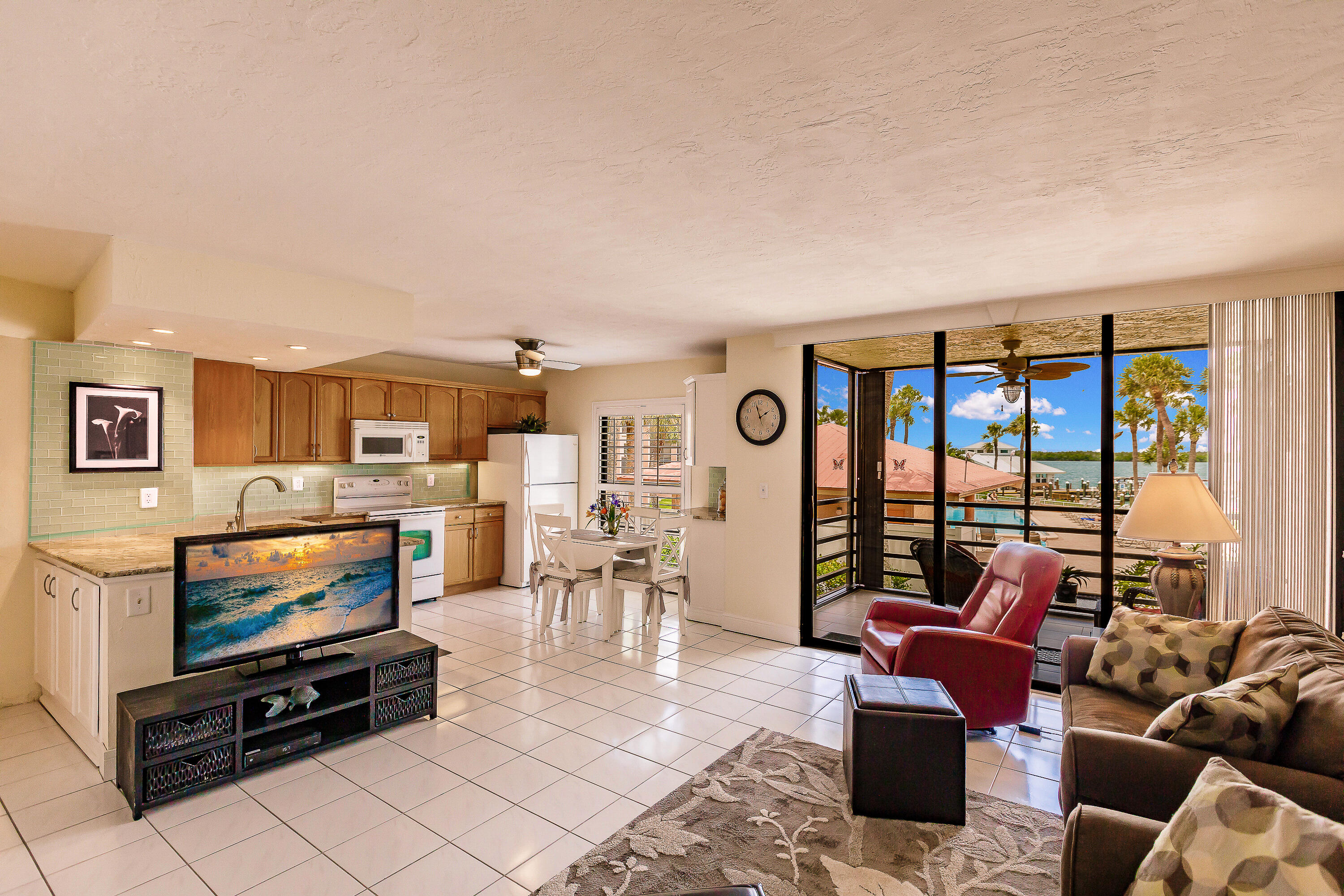New listing here at Riverside Club, a jewel of Marco Island! This beautiful condo has brand new carpeting in the bedroom, updated kitchen and bath, offers a full size washer and dryer, and hurrican shutters. Watch the sun rise as it comes up over the Jolly Bridge, follow the dolphins as they play, be amazed at the boat traffic and fish from the piers!  You will never tire of the magnificient wide-water views. Riverside Club's assessments include electric, which is rare to any condo or home owners association. Whether you are looking for a permanent home in Paradise, a seasonal one, or an investment, this is a must see for you! Additionally, you can lease a boat slip for $200/year. Riverside Club is within walking distance to boat and bike rentals and to the ''World Famous Snook Inn--Waterfront Dining'' and many other restaurants and shops. Rose Marina, is less than a mile away, this marina is the launch site for the Key West Express and they offer boat rentals as well.