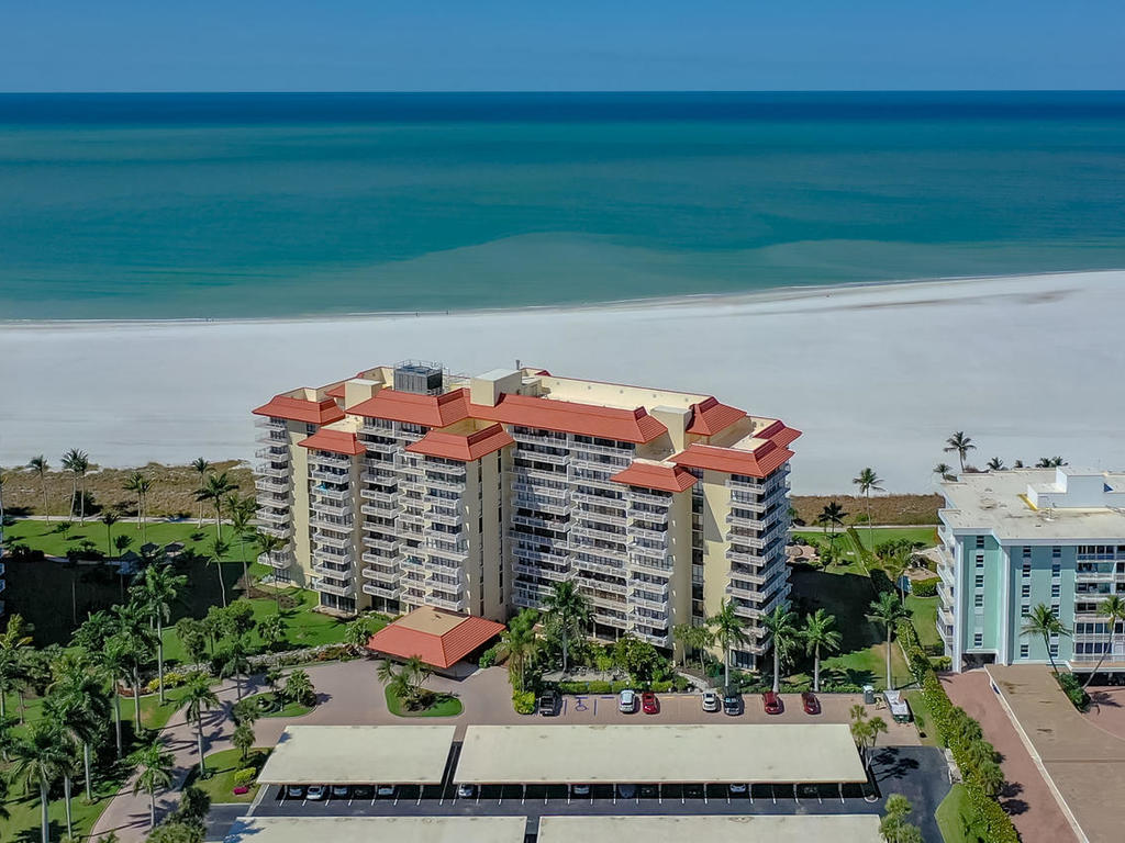 Live on the Beach. Tradewinds of Marco Island, located directly on the beach. Steps along private pathway to the beach, with beautiful city views. This furnished condo offers two bedrooms/two bathrooms, with newly installed impact glass sliders, full pull down blinds on windows combination electric and manual.. Carport with storage. Common laundry room and trash chute on every floor. Extra storage closet on every floor. Short distance to restaurants. The complex offers a secure Lobby, Manager on Duty Mon thru Friday. Social room with kitchen. Heated Pool, BBQ grill area.Live in a low density complex, with a desirable location on the beach