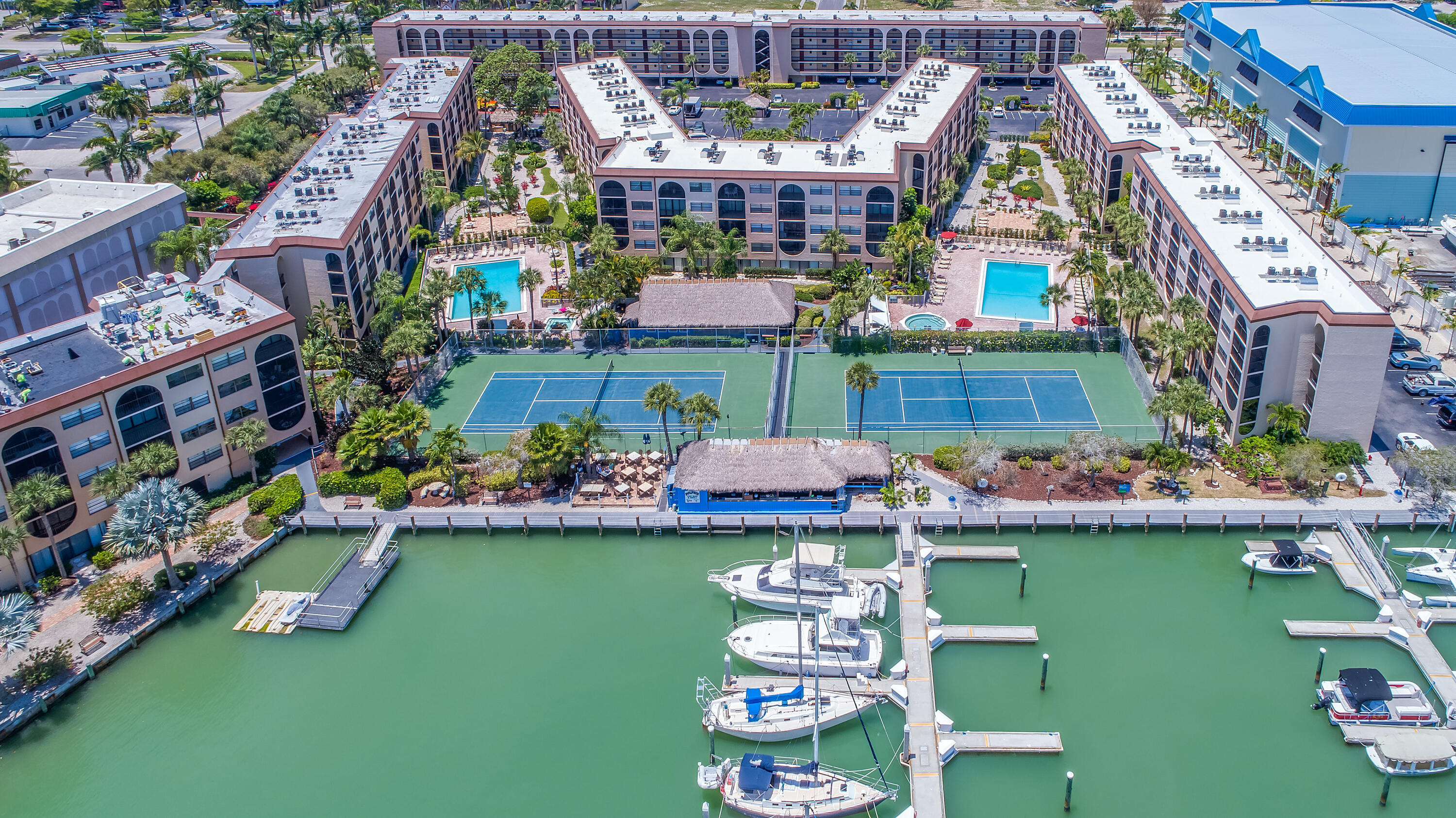 Lowest price waterfront bay view 2 bedroom weekly rental property on island.  Also, ideal for 2nd home at popular Anglers Cove.  Largely original finishes inside with upgraded flooring, you can freshen up with paint or more extensive renovations valuing the unit well above 500,000.  Currently rented through July 31 nearing the end of the annual lease, you have time to plan adding your personal touch to this opportunity.  And if you're still thinking about your best move, the current renter can continue month by month so you have some income.
