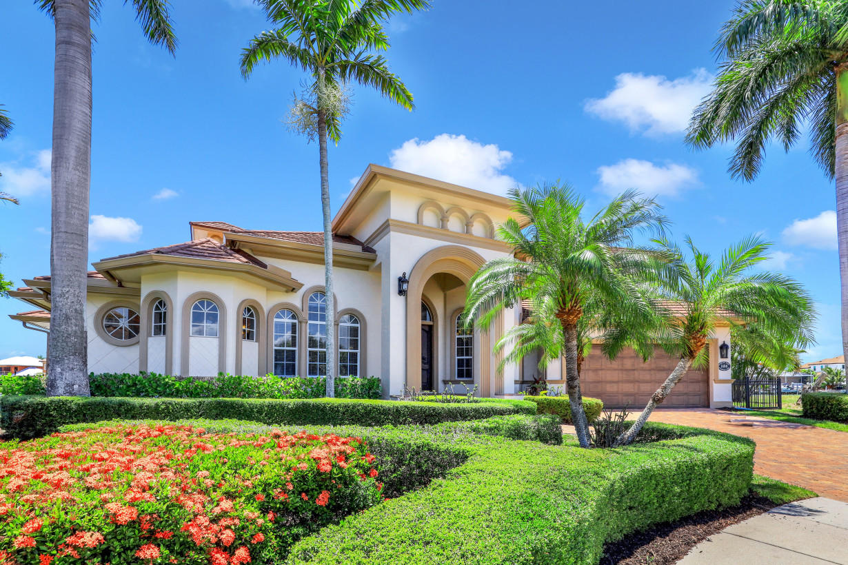 2021 ROOF, 2021 GUTTERS, UP TO 2021 CODE ELECTRICAL PANELS, FRESH PAINT EXTERIOR AND INTERIOR, 180' OF WATER DIRECT 2003 SEAWALL WITH 2 DOCKS, 2021 LANAI SCREENS, SOUTHWEST TIP LOT. SPECTACULAR SUNSETS sparkling in the expansive BIG WATER enjoyed FROM EVERY WINDOW. Incredible home for entertaining or comfortable family living with STUNNING ARCHITECTURAL DETAILS, 14' CEILINGS, 10' SLIDERS, EXPANSIVE MITRED BAY WINDOW, IMPACT GLASS and ELECTRIC HURRICANE SHUTTERS. Featuring, 4 BEDROOMS, 2 LARGE MASTERS with breakfast kitchens. EACH WITH A MICROWAVE, REFRIG/WINE COOLER and upstairs DISHWASHER, WASHER AND DRYER and BOTH WITH luxurious baths. 4 BATHS, PLUS A POOL BATH AND POWDER ROOM. LIBRARY ON THE 1ST FLR AND COMFORTABLE SITTING/TV ROOM UPSTAIRS. CHEF'S KITCHEN with INCREDIBLE OVERSIZE BUTLER'S PANTRY WITH WET BAR, DISHWASHER, DOUBLE WINE COOLER and DECORATIVE DESIGNER WINE CABINET- double SUB ZERO, 48'' GAS RANGE, DISHWASHER, APPLIANCE CABINET, CENTRAL VAC WITH DUSTPAN, and HUGE ISLAND AND OF COURSE GRANITE EVERYWHERE. ELEVATED WASHER AND DRYER IN THE LARGE LAUNDRY WITH MORE PANTRY SPACE. FLORIDA OUTDOOR LIVING AT IT'S BEST WITH MULTIPLE LANAI'S. Take the tour!! WELCOME HOME!!!