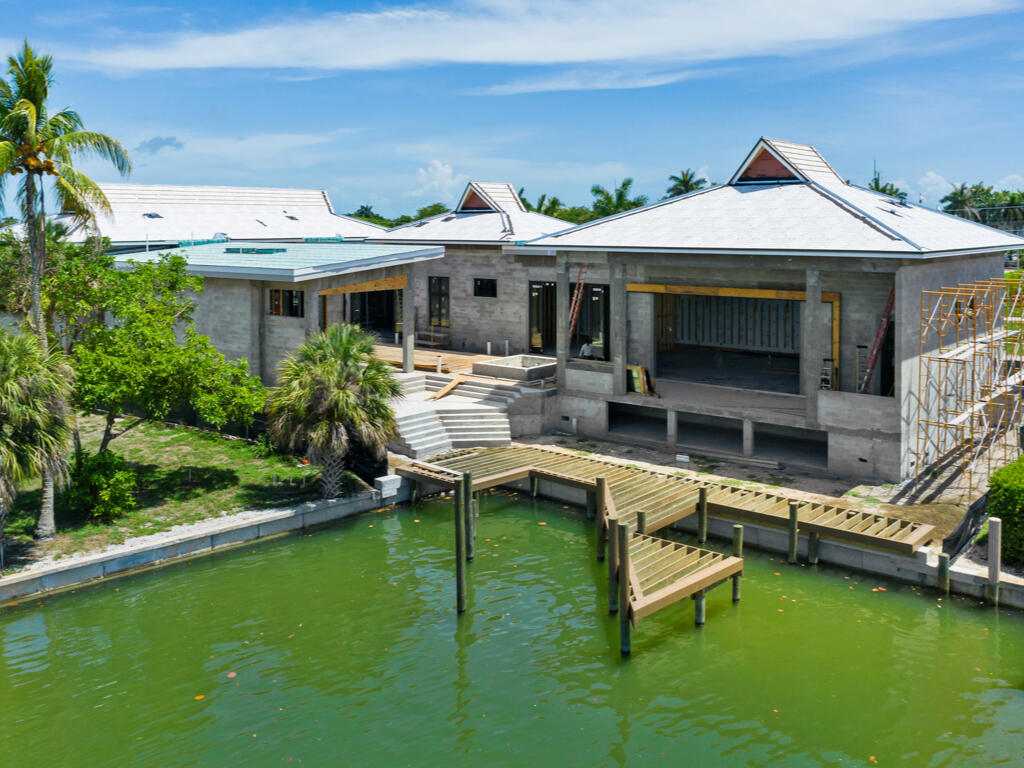 Introducing the Makaha, the latest addition to the bespoke, Luxury Resort Home Collection by Paradise Design Build. Exceptional, courtyard-style, 4 bed/4 full & 1 half bath, 6-car garage estate on an oversized corner lot offers deep-water views w/direct Gulf access. 4,500 sq ft under air, built to the highest quality, safety, elevation & green building standards, exceeding Miami Dade specifications, with premium features such as 12-foot glass sliders, engineered roof & LEED-standard insulation. Expansive, light-filled, custom-designed interior features a great room floor plan seamlessly connecting the huge gourmet kitchen and 1,200 sq ft of outdoor living area. Experience tranquility in the private courtyard with pool bath, sundeck & summer kitchen, or float the day away in the 50-foot lap pool & 12-person Euro-edge spa. Across the courtyard, indulge in the 900 sq ft cabana villa with lounge, wet bar, large master suite, en-suite, laundry & indoor & outdoor showers. Set sail from the new, custom dock & seawall w/premium boat & waverunner lifts & ship-to-shore power. All of this, only one block to the Island Country Club. Convenient to beach, boutiques and restaurants.