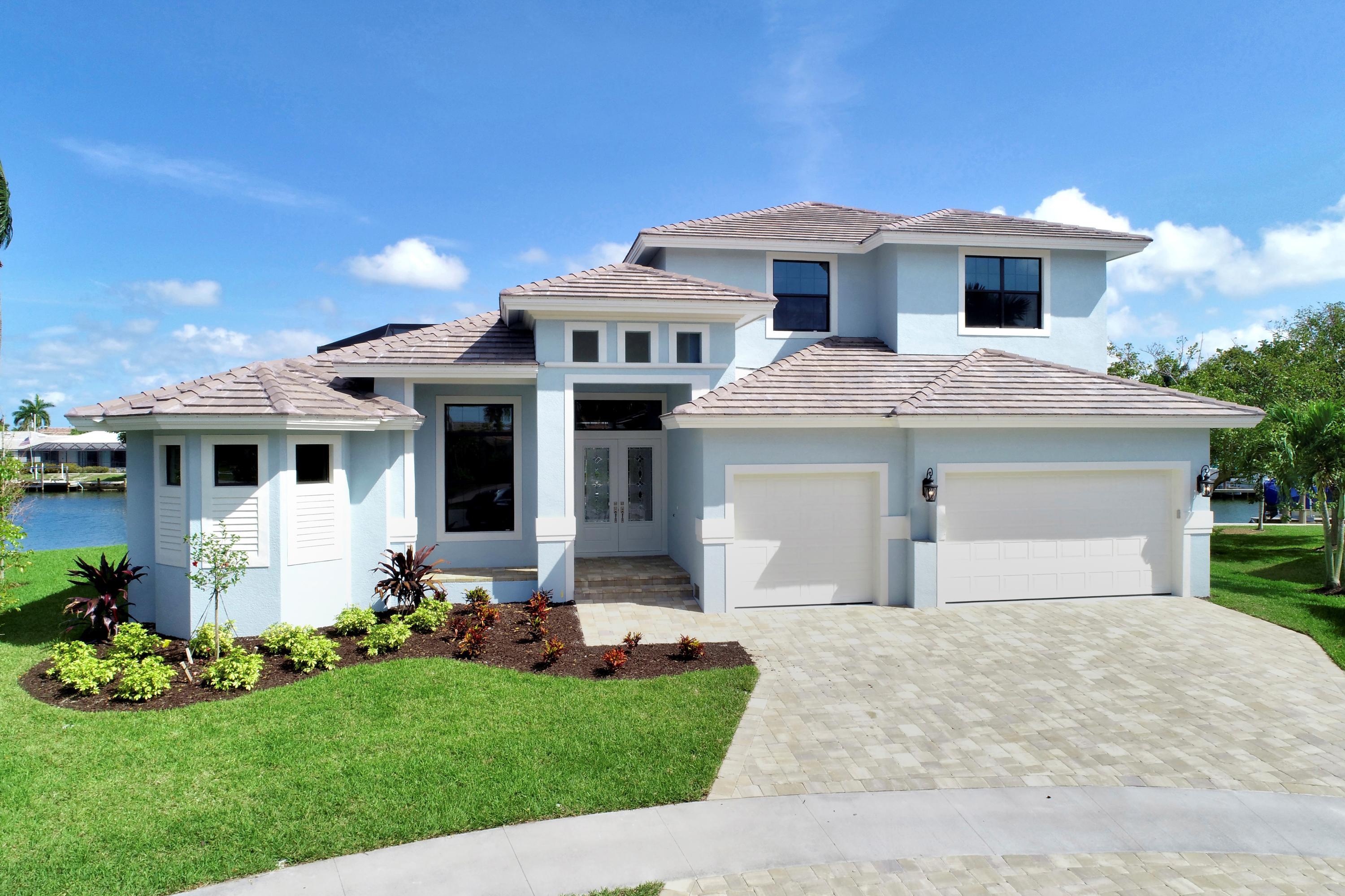 Brand New Custom built home with over 3200 square feet under air in one of the best areas of the Island!  Only a 10 minute walking distance to Resident's Beach!  Enjoy your morning breakfast at Doreen's Cup of Joe just a 4 minute walking distance away.  Boating indirect access under the new higher Collier Bridge allows larger boats through Smokehouse and Collier Bay.  80 feet of water frontage with new seawall and view of converging canal.  4 bedrooms with two master suites, 3 and half baths plus large den, large bonus storage room, chef's kitchen, 2nd floor lanai enclosed outdoor balcony to enjoy converging canal view, home flows great with high ceilings all around and large open spaces.  3 zone A/C, 3 car garage with epoxy floors.  Enjoy the panoramic view lanai with outdoor summer kitchen, pool and spa surrounded by stunning shell stone to create the perfect outdoor lifestyle to enjoy the Marco Island Lifestyle!  Home is under construction at this time, but is running ahead of schedule to be completed Oct/Nov 2021, still a small window of time to make cosmetic choices, color of stone, indoor paint, and finishes to add your personal touch!