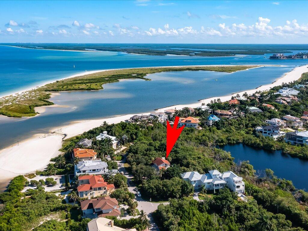 Only a fortunate few enjoy the Hideaway Beach lifestyle on Marco Island.  This unique beach  gated community is unlike any other in Naples, Sanibel or the Ft Myers area.  Over 314 acres sprawling along 4 miles of ocean shoreline and beach, designed for less than 650 families, undiscovered Hideaway Beach offers privacy, 2 gate houses, golf, multiple soft surface tennis courts, a wonderful staffed fitness room full of natural light, miles of private roads and paths to keep you in shape.  Our recently redecorated beach club house is wow, offers you 4 restaurant dining areas - all on the beach, a heated pool and hot spa, and personalized service. The owners chose this 4 bedroom 4 bath home because they are walking distance to the beach, clubhouse, hear the waves and birdsong in this natural paradise.  Sunbathe around the spacious heated pool - only nature watches. Impact windows and abundant natural light caress the main and upper living levels.  The 21 ft high vaulted white washed wood ceilings in living room and master bedroom say ' beach home' More: coral fireplace, tile floors throughout, gourmet kitchen open to living area with white beach cabinets, modern finishes, en suite configurations