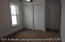 2nd floor bedroom has his and her closet, 12' x 10'