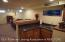 Large Wet Bar! Floating floor just to be safe but basement has a B-Dry system with lifetime of the home warranty. Seller leaving bar refrigerator for Buyer!