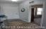 9' ceilings welcomes you as you enter the foyer with a lg. coat closet and opening to the current office - could be another BR, if needed.
