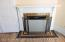 2nd wood burning fireplace with ceramic surround